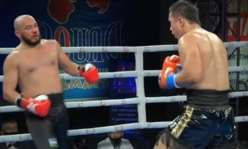 Как казахстанский тяжеловес встал после нокдауна и оформил нокаут узбека в бою за титулы WBC и WBA. Видео боя